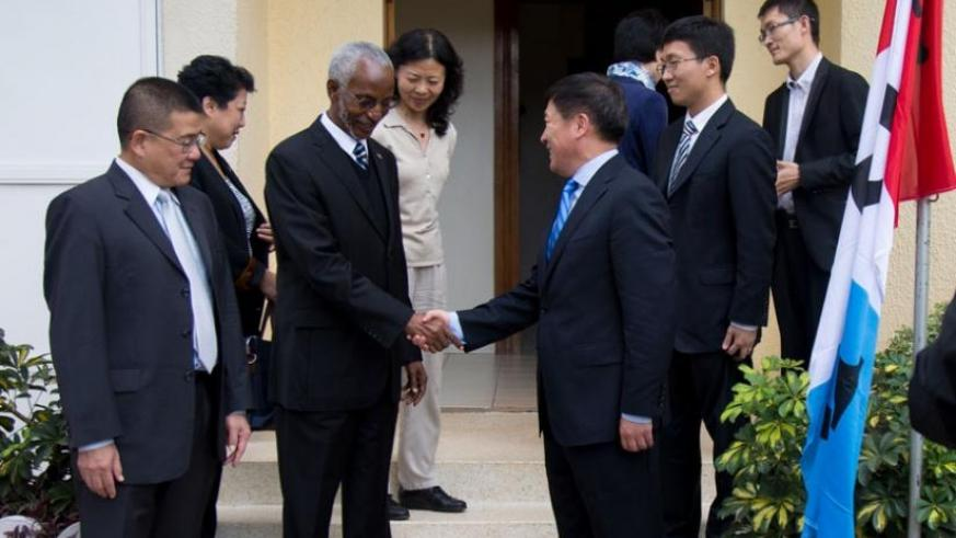 RPF Secretary-General Francois Ngarambe (L) shakes hands with Wang Heming, the deputy director-general for African Affairs in the Communist Party of China, in Kigali yesterday. (Ti....
