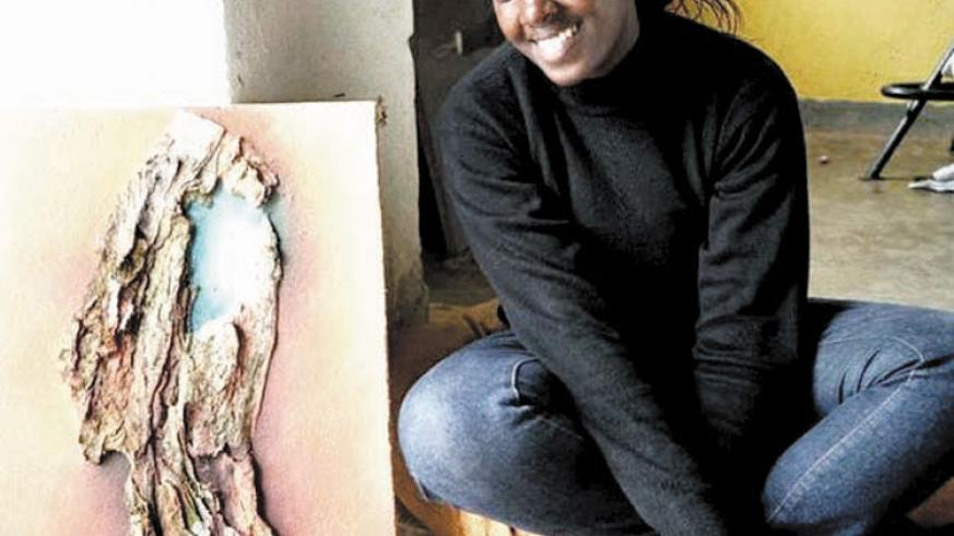 Hortance Kamikazi with one of her art paintings. (Joseph Oindo)