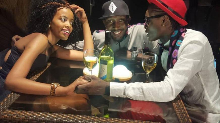 DJ Pius (C) and Dr Jose Chameleon with model, Nikita Ndori during the shooting of the Agatako video (Courtesy)
