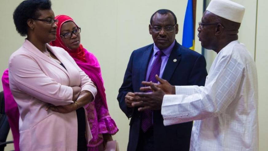 Minister Gatete (2nd right) chats with Speaker of the Chamber of Deputies Donatille Mukabalisa (L), and her deputy Abbas Mukama (R), and Senate vice-president Fatou Harerimana at P....