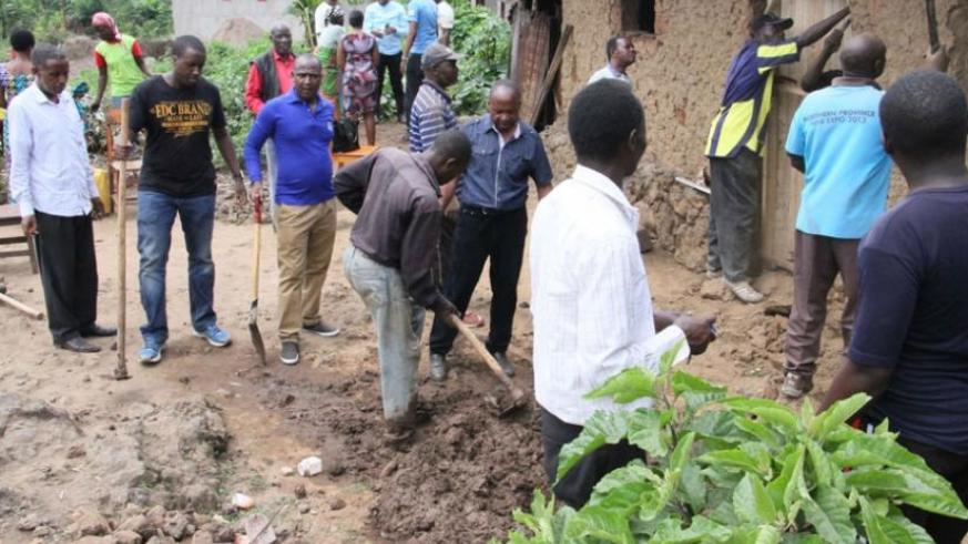 Members of the citizen forum in Musanze District renovate house for a vulnerable resident. (Courtesy)