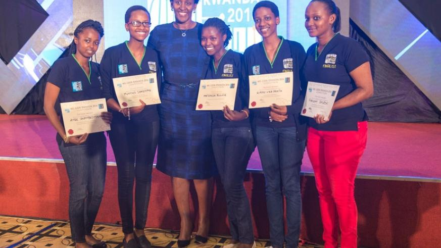 First Lady Jeannette Kagame poses with the Ms Geek finalists yesterday. Rosine Mwiseneza (3rd from right) won this year's Ms Geek edition. (Courtesy)