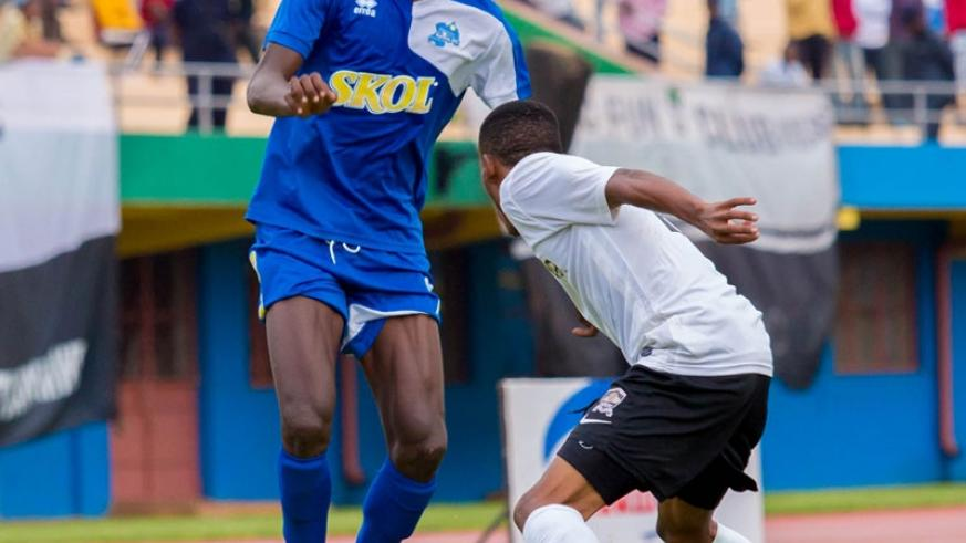 Rayon Sports striker Davis Kasirye tries to go past APR's left-back Eric Rutanga in the first round fixture that ended goalless. (File)
