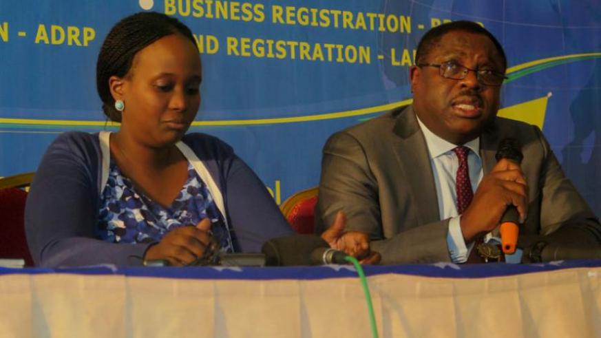 IGF CEO, Asiko (R) speaking during a press conference at the closing ceremony of the ICF funded business environment projects as Kanyonga, the Registrar General at RDB (L) looks on....
