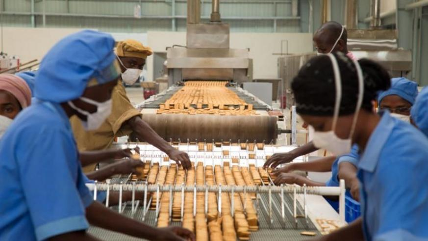Workers at ADMA Biscuit factory in Kigali sort biscuits. (Timothy Kisambira)