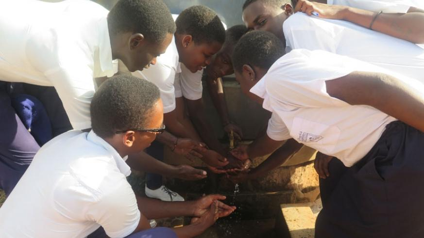 Students wash their hands. Proper hand hygiene before eating food is very crucial. (Solomon Asaba)