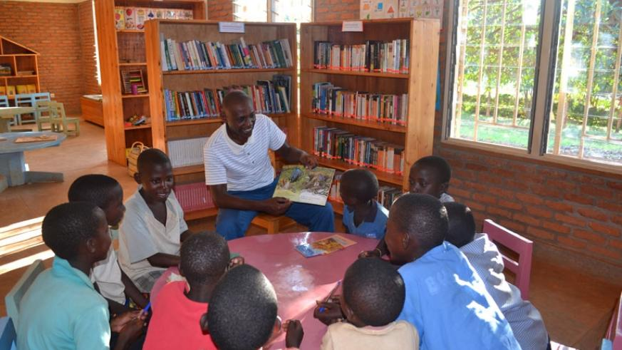 Children take part in an open reading session at the library. (Lydia Atieno)