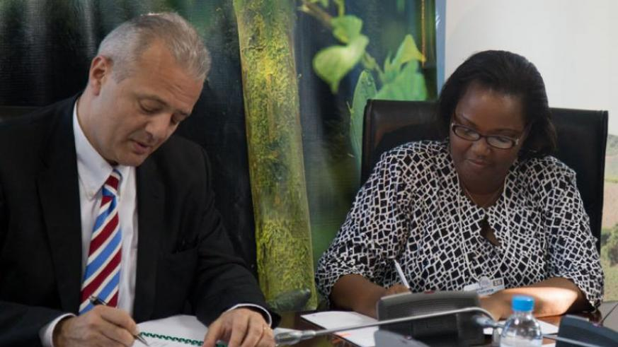 Camille Z.Chammas Unilever vice President Procumbent supply-Chain and sustainability (L) and Geraldine Mukeshimana, Agriculture Minister  sign the agreement. (T.Kisambira)
