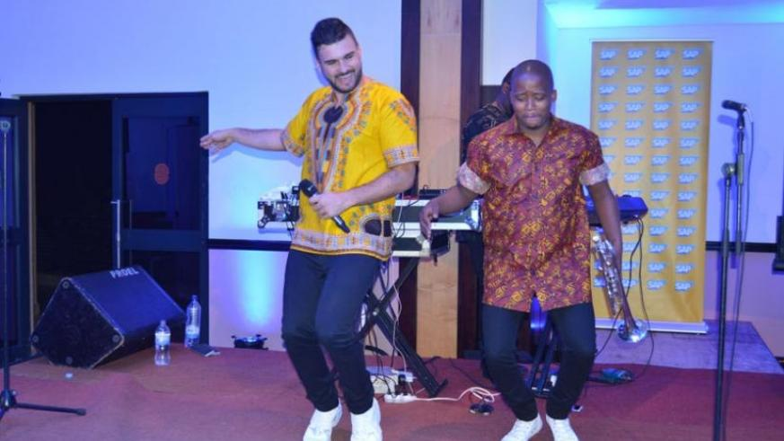 (L-R) J' Something and Mo-T pull dance moves during their performance at Serena.
