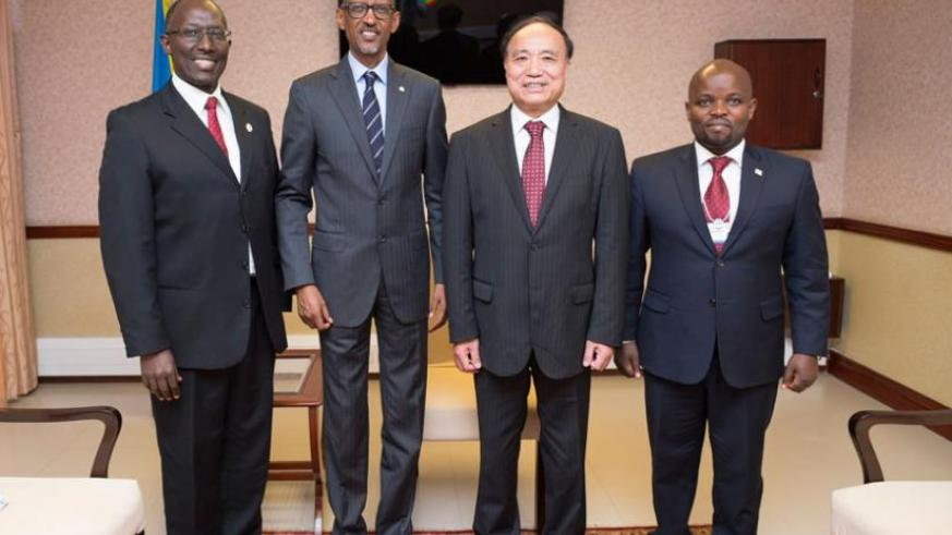 President Kagame with Houlin Zhao (2nd left), the Secretary General of the International Telecommunication Union (ITU), who was accompanied by Andrew Rugege (L), the ITU Regional D....