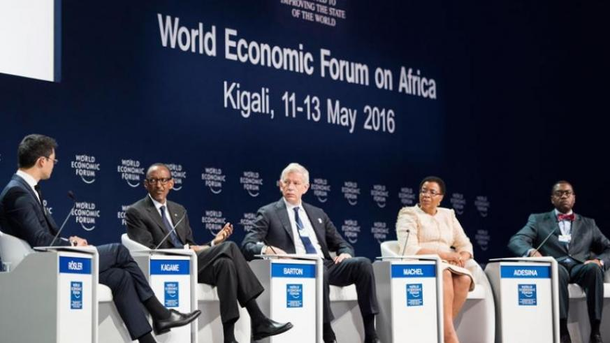 President Kagame together with World Economic Forum managing director Philipp Rosler ; Dominic Barton, Global Managing Director, McKinsey & Company; Graca Machel, Founder, Foundati....