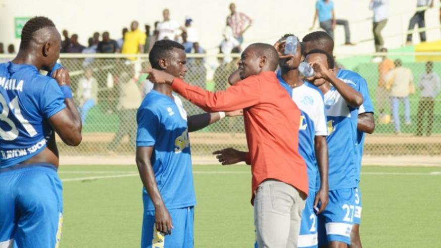 Rayon Sports coach Djuma Masudi gives instructions to his players on Wednesday at Kigali Regional Stadium. The blues thrashed Bugesera FC 4-0 to keep pressure on defending champion....