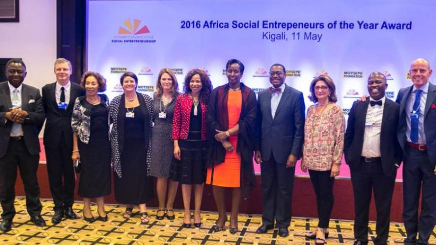 The First Lady poses with Dr Motsepe (to her right), Dr Akinwumi Adesina (to her left), Dr Babatunde Osotimehin (first left), Adrian Monck (second left), Dr Motsepe-Ramaphosa (thir....