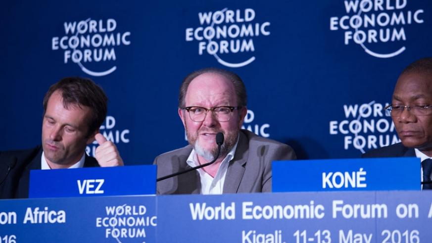 Vez (C) speaks at the WEF session on cybercrime in Kigali on Wednesday as Hall (L) and Koné  look on. (Timothy Kisambirai)
