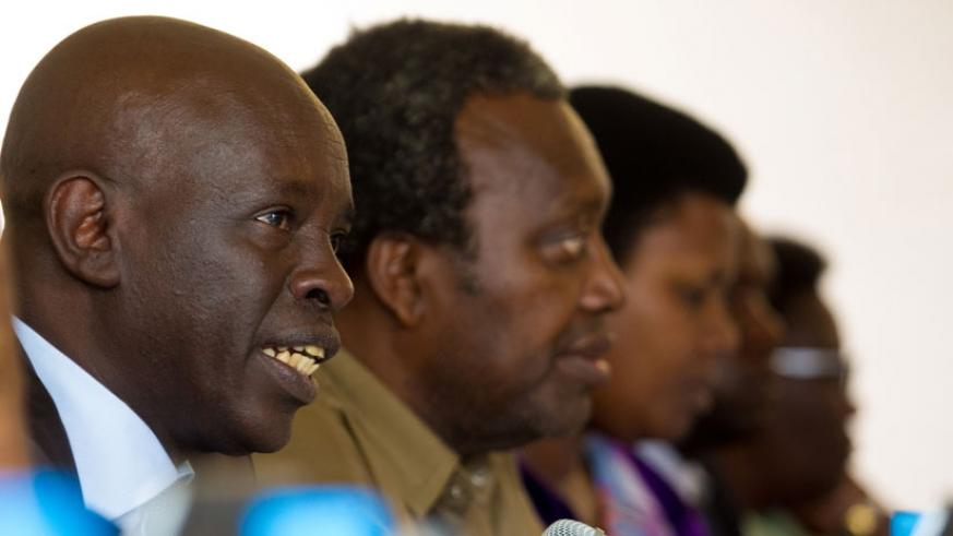 MP Karenzi speaks as PAC chair Juvenal Nkusi and other members of PAC look on. (Timothy Kisambira)