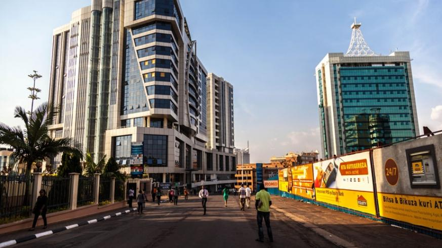 Pedestrans walk through the Car-Free Zone in Kigali. The idea was initially criticised but city dwellers have since warmed up to it. (T. Kisambira)