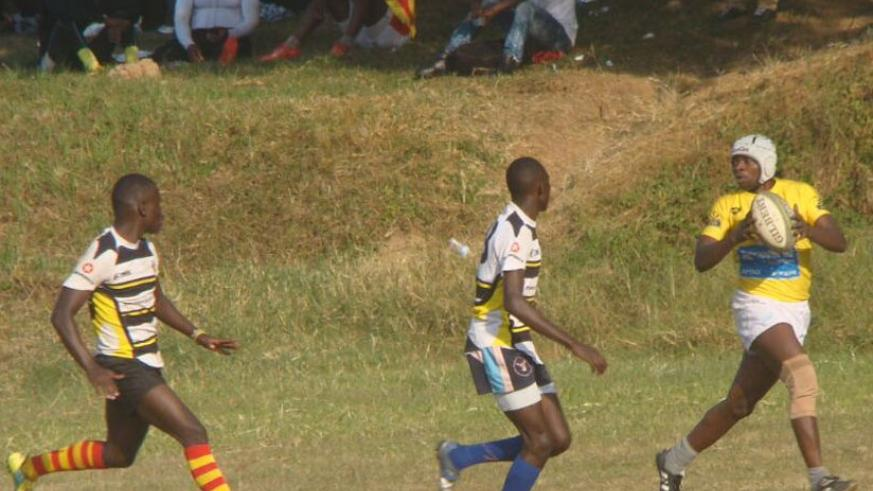 Jinja Hippos players close in on Lion de Fer winger Ignas Nsanzimana in the semifinals. Jinja went on to win the tourney. (S. Kalimba)
