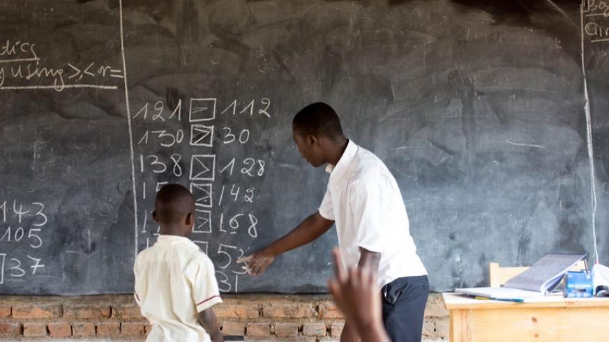 A teacher instructs a pupil at Rusheshe Primary school in Kicukiro district. (TKisambira.)