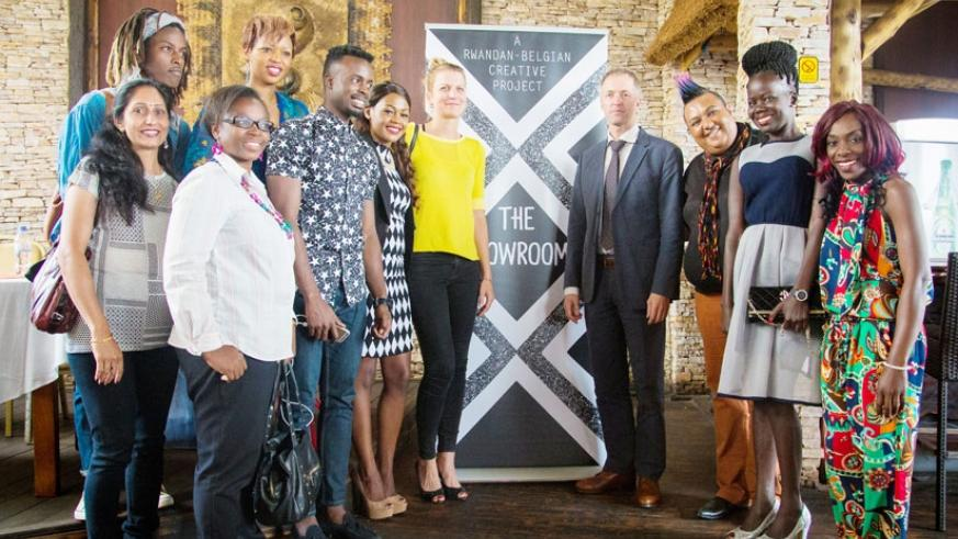 Designers pose in a group photo with Arnout Pauwels (in a suit), the Belgian Ambassador to Rwanda after the press conference. (All photos by Faustin Niyigena)