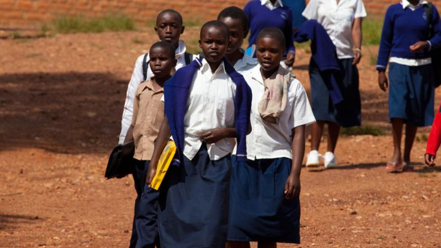 Students walking to school. Research shows that long distances to school affect students' concentration. (Timothy Kisambira)