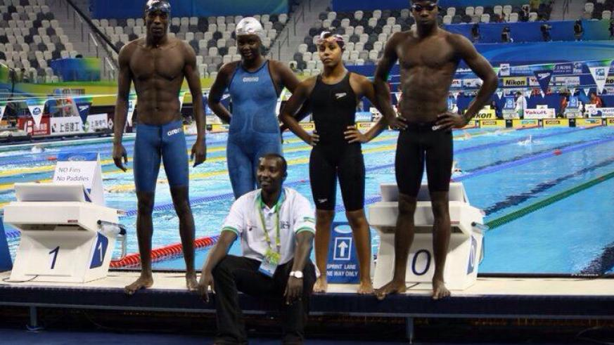 Imaniraguha (R) and Umurungi (in black) along with other swimmers pose for a photo after a training session Shanghai, China. (Courtesy)
