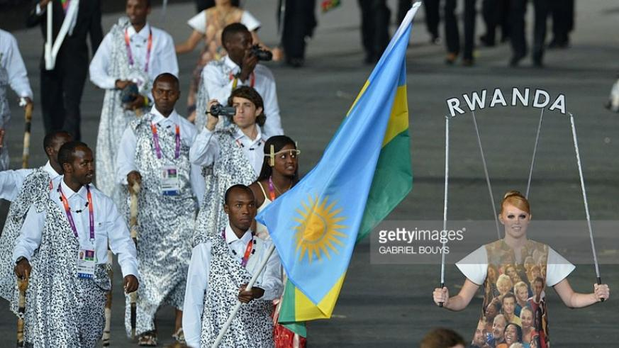 Adrien Niyonshuti (C) leads Rwanda delegation during the opening ceremony of the London 2012 Olympic Games. (Courtesy)