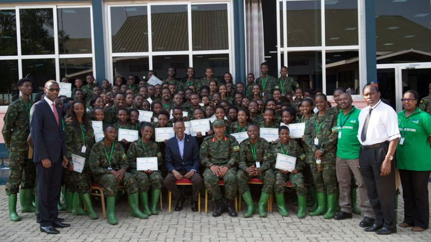 President Kagame in a group photo with officials and graduates of the ninth edition of civic education training (Itorero) at Gabiro School of Infantry in the Eastern Province's Gatsibo District yesterday. The President urged the youth never to run away from playing their role in contributing toward the country's socio-economic development, saying it is never too late to contribute. He told the Intore that contributing starts with 'knowing who and what you want to be and doing it with purpose.' / Village Urugwiro.