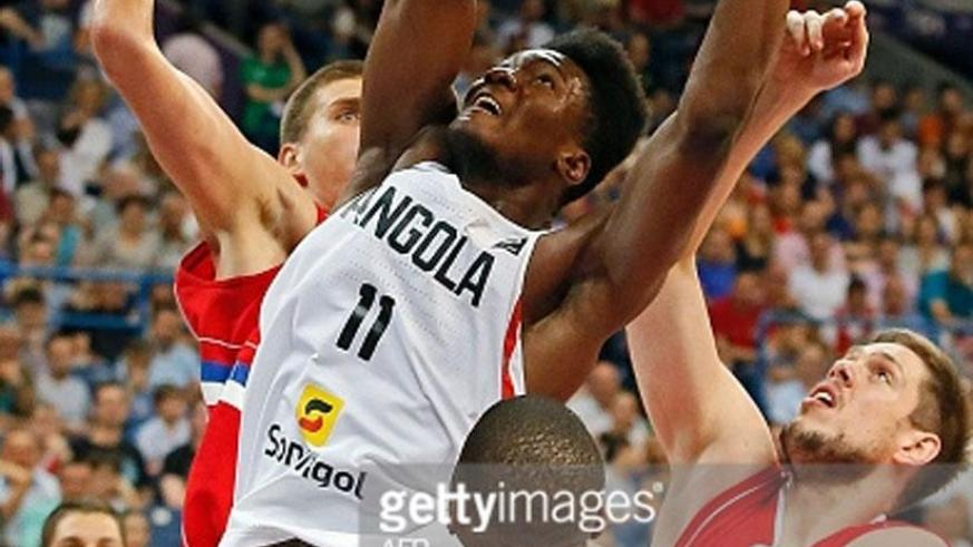 Angola's Bruno Fernandes (C) vies for the ball with Serbia's Vladimir Stimac (R) during the 2016 FIBA World Olympic Qualifying basketball match. (Net photo)