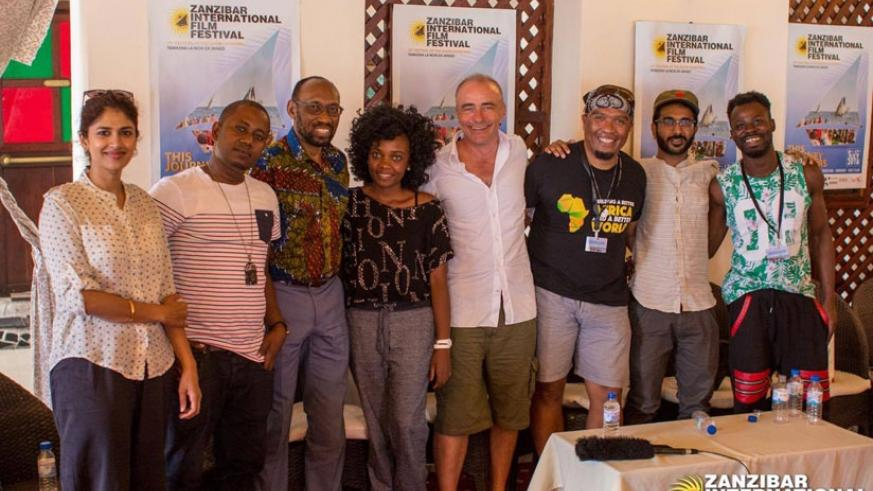 Clementine Dusabejambo, 28, (4th from left) poses for a group photo with other filmmakers.