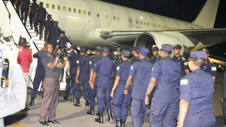 RWAFPU7 contingent boarding a plane at Kigali International Airport for a UN mission in Haiti. / Courtesy