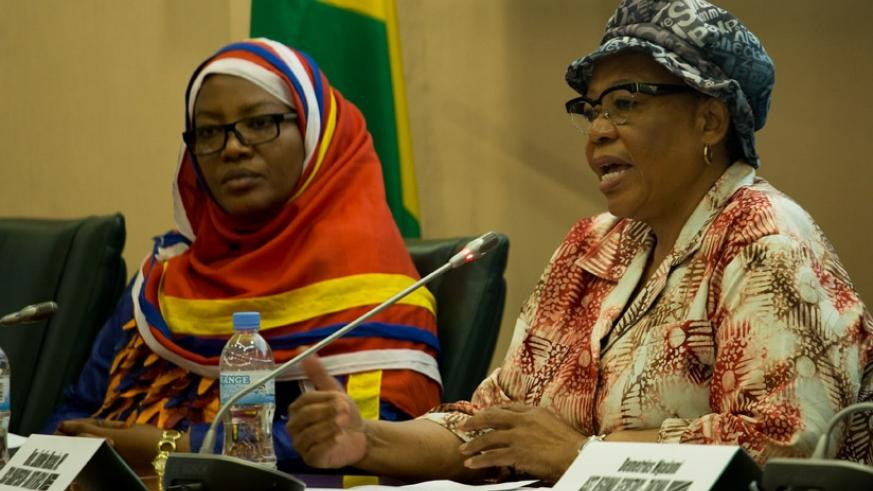 The Chairperson of the executive committee of the Commonwealth Parliamentary Association, Lindiwe Maseko, briefs journalists as Senate vice-president Fatou Harerimana looks on. / T....