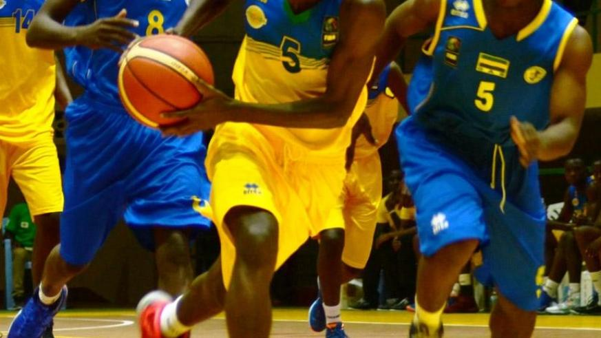 Jean-Jacques Nshobozwabyosenumukiza led Rwanda's charge, scoring a game high 22 points in the 94-64 win over Gabon in Group A, yesterday. / Sam Ngendahimana.