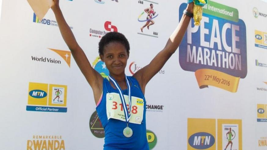 Nyirarukundo celebrates after finishing second in the 2016 Kigali Peace Half Marathon in May. / File.