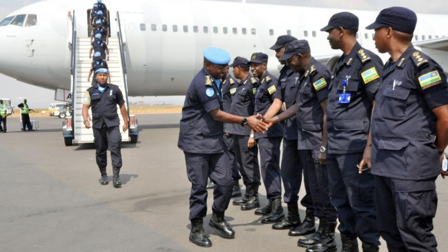 Commissioner of Police Joseph Mugisha greets Rwanda National Police who were receiving the returning contingent of Rwanda National Police UN peacekeepers from Haiti at Kigali Inter....