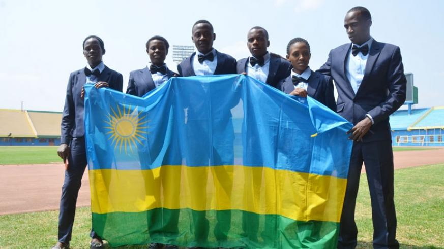 The team that represented Rwanda at the just concluded 2016 IAAF World U-20 Junior Championship in Poland, pose with the national flag before deparure. (Sam Ngendahimana)