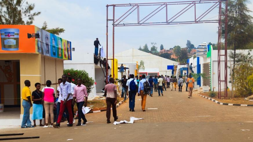 Some of the exhibitors setting up their stalls at the Gikondo Show Grounds yesterday. (Nadage Imbabazi.)