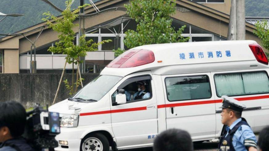 An ambulance outside the facility for disabled people where at least 15 people have been killed and dozens injured in a knife attack in Sagamihara, outside Tokyo. / AP