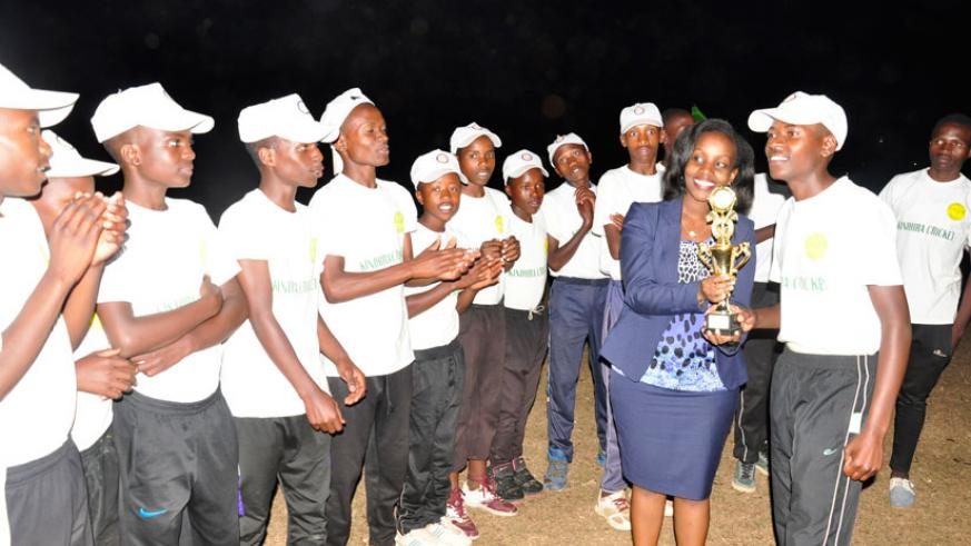 Lycee de Kigali cricket players celebrate with their trophy. / Pontian Kabeera.