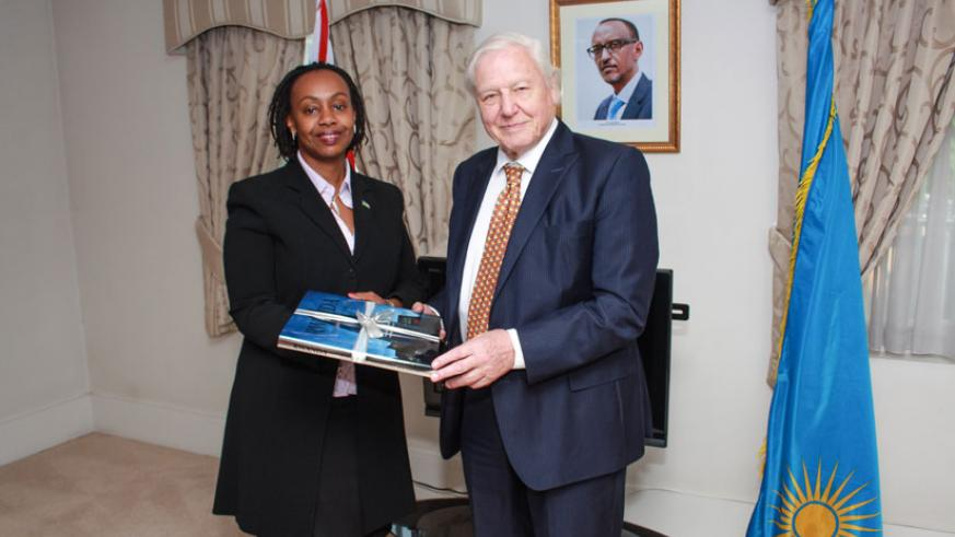 Her Excellency Yamina Karitanyi the High Commissioner of Rwanda to the UK presenting a gift to Sir David Attenborough at the High Commission.