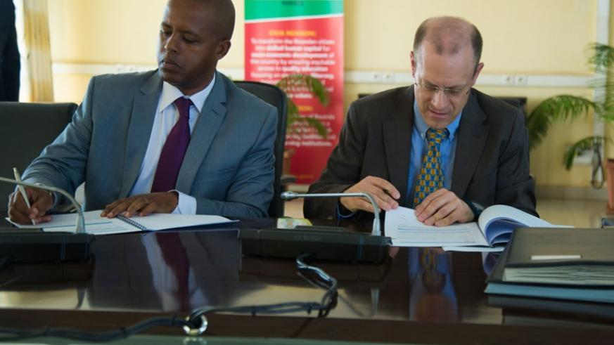 The Director General of WDA, Jerome Gasana (L), signs a Memorandum of Understanding with Alexandre Boin, Director for Rwanda, DR Congo and Burundi, Swiss Foundation for Technical C....