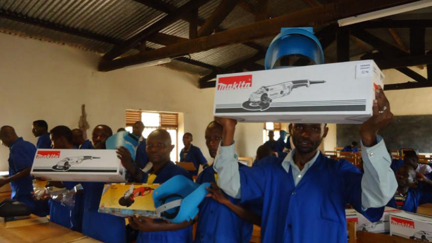 The former FDLR combatants were given tool kits upon graduation. / John Mbaraga.