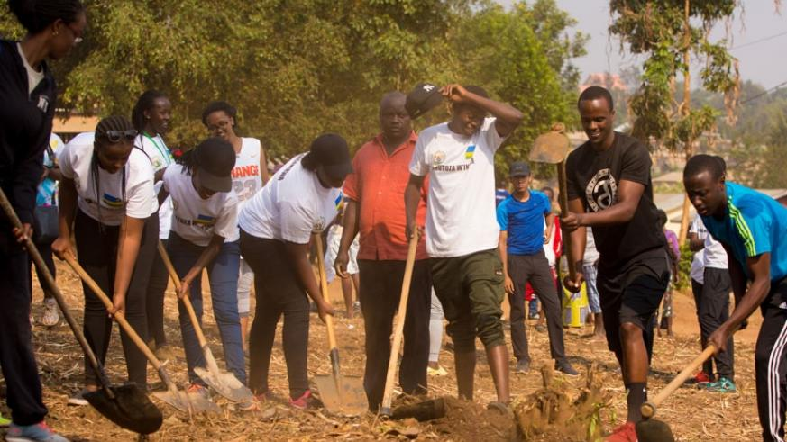 Members of the Rwanda youth forum who include diaspora students take part in Umuganda yesterday at Peace and Hope Initiative nursery school in Kinyinya. / Timothy Kisambira