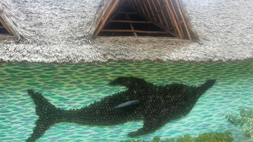 A mural of a dolphin made with bottles picked from the beaches. / Allan Brian Ssenyonga.