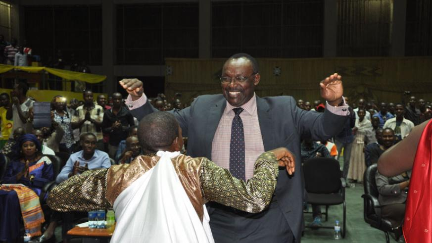Francois Kanimba, minister for Trade and Industry dances along with one member of Nkombo Island based dance troupe. (All photos by Teddy Kamanzi)