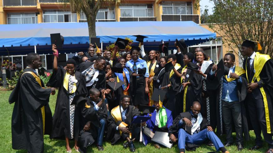 The graduates pose for a group photo at the event held in Kigali yesterday to mark their success. / Lydia Atieno.