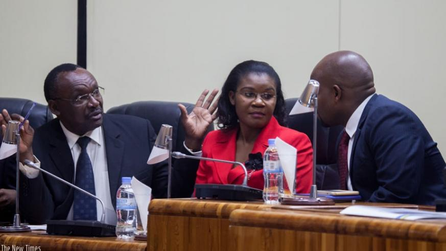 Cabinet ministers (L-R) Francois Kanimba of Trade and Industry,  Judith Uwizeye of Public Service and Labour, and Jean Philbert Nsengimana of Youth and ICT consult with each other ....