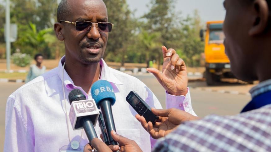 Reuben Ahimbisibwe, the official in charge of infrastructure in the City of Kigali, speaks to the media about the new changes to traffic pattern in the areas around the Kigali Conv....