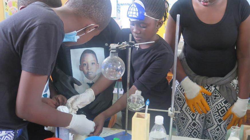 Students perform experiments in a laboratory. Part of the reason why tuition fees for science courses have been revised is to cater for the high expenses that come with the these c....