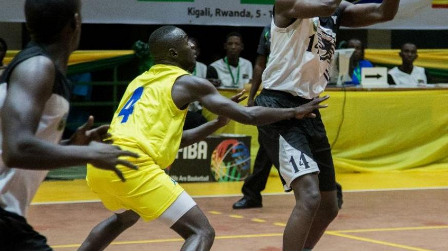 Rwanda's Olivier Shyaka (R) finished with the game high 28 points as RDF beat TPDF 78-64 on Wednesday. / Faustin Niyigena.