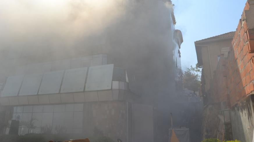 The smoke could be seen covering the house as police fire fighting brigade tried to put the fire off. (Jean d'Amour Mbonyinshuti)